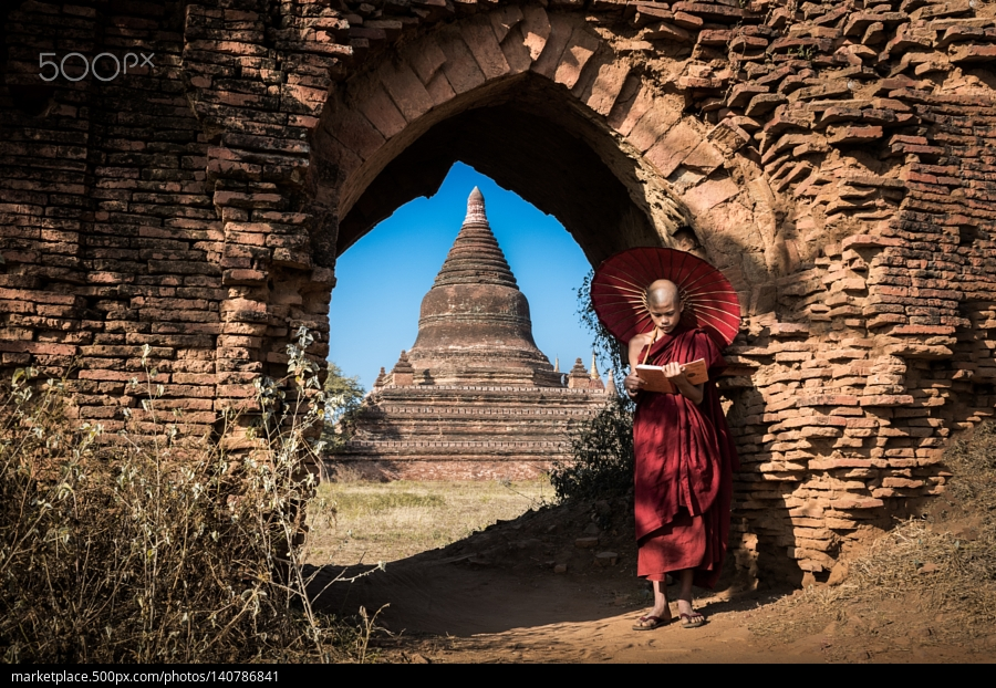 Myanmar monk reading a book at old Bagan, Myanmar.